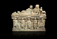 "Roman relief sculpted sarcophagus of Aurelia Botiano and Demetria depicted reclining on the lid, 2nd century AD, Perge Inv 1.35.99. Antalya Archaeology Museum, Turkey.<br /> <br /> it is from the group of tombs classified as. ""Columned Sarcophagi of Asia Minor"". The lid of the sarcophagus is sculpted into the form of a ""Kline"" style Roman couch on which lie Julianus &  Philiska. This type of Sarcophagus is also known as a Sydemara Type of Tomb.. Against a black background."