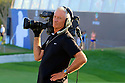 Cameraman John Wensley preparing for action during the final round of the DP World Golf Championship played at the Earth Course, Jumeira Golf Estates, Dubai 19-22 November 2015. (Picture Credit / Phil Inglis )