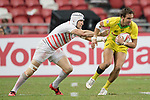 Phil Burgess of England (left) competes for the ball with John Porch of Australia (right) during the match Australia vs England, the Bronze Final of Day 2 of the HSBC Singapore Rugby Sevens as part of the World Rugby HSBC World Rugby Sevens Series 2016-17 at the National Stadium on 16 April 2017 in Singapore. Photo by Victor Fraile / Power Sport Images