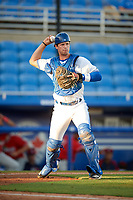 Dunedin Blue Jays catcher Riley Adams (23) throws to first base during a game against the Fort Myers Miracle on April 17, 2018 at Dunedin Stadium in Dunedin, Florida.  Dunedin defeated Fort Myers 5-2.  (Mike Janes/Four Seam Images)