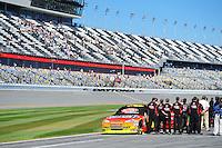 Feb 08, 2009; Daytona Beach, FL, USA; NASCAR Sprint Cup Series driver Jeff Gordon stands with his crew during the national anthem prior to qualifying for the Daytona 500 at Daytona International Speedway. Mandatory Credit: Mark J. Rebilas-