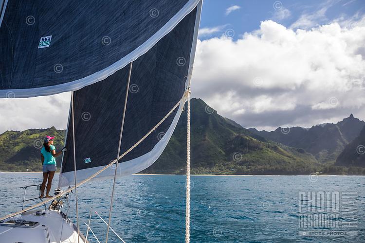 Sailboat Sarasvati cruises along the Na Pali Coast on Kaua'i.