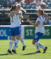 Kelly Shmedes (3) is congratulated by Mary-Frances Monroe (center) and Jennifer Nobis (19) after scoring in the first half. Boston Breakers defeated FC Gold Pride 1-0 at Buck Shaw Stadium in Santa Clara, California on July 19, 2009.