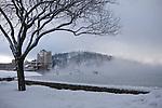 Idaho, Coeur d' Alene. Fog shrouds the boardwalk  around the Coeur d' Alene Resort on Lake Coeur d' Alene on a snowy day in winter.