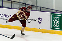 WORCESTER, MA - JANUARY 16: Alexie Guay #16 of Boston College passes the puck during a game between Boston College and Holy Cross at Hart Center Rink on January 16, 2021 in Worcester, Massachusetts.