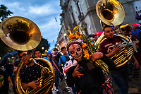 A Mexican woman, wearing a scull mask and followed by brass band musicians, performs on the street during the Day of the Dead festival in Oaxaca, Mexico, 30 October 2019. Day of the Dead (Día de Muertos), a religious holiday combining the death veneration rituals of Pre-Hispanic cultures with the Catholic practice, is widely celebrated throughout all of Mexico. Based on the belief that the souls of the departed may come back to this world on that day, people gather together while either praying or joyfully eating, drinking, and playing music, to remember friends or family members who have died and to support their souls on the spiritual journey.