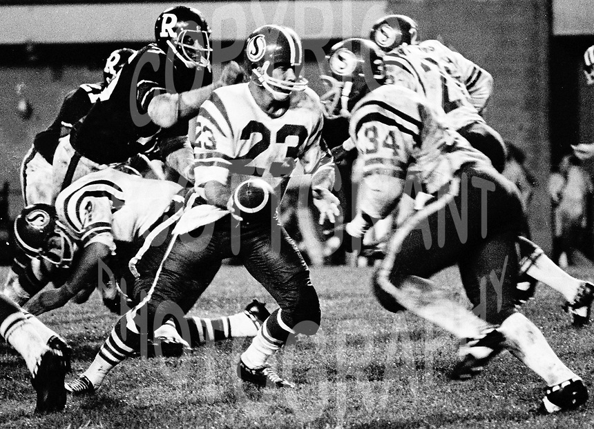 Ron Lancaster Saskatchewan Roughriders quarterback. handoff to George Reed. Saskatchewan Roughriders vs Ottawa Rough Riders 1972. Copyright photograph Scott Grant