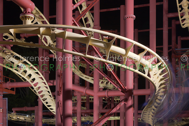 A coaster car flies by at night on the Super Flight at Rye Playland, Rye, New York