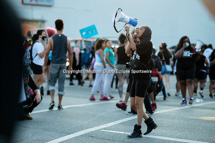 """September 5, 2020: Black Lives Matter protesters block off the intersection of Taylor Boulevard and Central Avenue after the 146th Kentucky Derby. With the Kentucky Derby being the biggest sports event for the State of Kentucky, protestors have chosen the  event as a focal point for their calls for justice in the death of Breonna Taylor. Multiple groups from around the country have converged on Louisville to protest during the """"Run for the Roses"""" at Churchill Downs in Louisville. Michael Clubb/Eclipse Sportswire/CSM"""