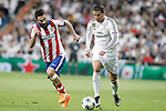 Real Madrid's Cristiano Ronaldo (r) and Atletico de Madrid's Arda Turan during Champions League 2014/2015 Quarter-finals 2nd leg match.April 22,2015. (ALTERPHOTOS/Acero)