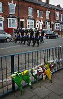 Police search the streets past flowers where 21 year old Haroon Jahan, and brothers Shazad Ali (30) and Abdul Musavir (31) were killed on Tuesday evening in a hit and run incident by suspected looters as they guarded a petrol station forecourt with many other people on Dudley Road in the Winson Green area of Birmingham, which was hit by a surge of rioting and looting. The violence started in London on Saturday evening after a peaceful protest in response to the shooting by police of Mark Duggan during an attempted arrest escalated into a riot, but has now spread to other areas in the country.