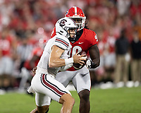 ATHENS, GA - SEPTEMBER 18: Luke Doty #4 looks for help as Tramel Walthour #90 bears down on him during a game between South Carolina Gamecocks and Georgia Bulldogs at Sanford Stadium on September 18, 2021 in Athens, Georgia.