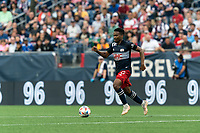 FOXBOROUGH, MA - JULY 25: Wilfrid Kaptoum #5 of New England Revolution dribbles at midfield during a game between CF Montreal and New England Revolution at Gillette Stadium on July 25, 2021 in Foxborough, Massachusetts.