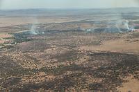 Tanzania.  Aerial View, Serengeti National Park, Controlled Burning.  Burning stiumulates new growth and reduced tsetse fly population.