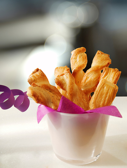 Cheese straw twizzles with party streamer.