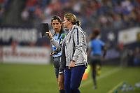 CHARLOTTE, NC - OCTOBER 03: Jill Ellis Manager of the United States has a few words with the AR during their game versus Korea Republic at Bank of American Stadium, on October 03, 2019 in Charlotte, NC.