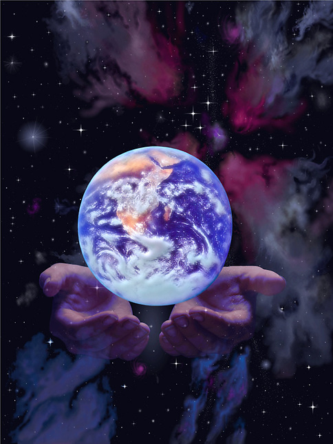 Earth floating above hands