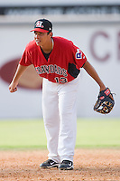 Shortstop Edwin Garcia #13 of the Hickory Crawdads on defense against the Greensboro Grasshoppers at  L.P. Frans Stadium July 10, 2010, in Hickory, North Carolina.  Photo by Brian Westerholt / Four Seam Images