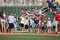 Young fans line up for their chance to run the bases following the South Atlantic League game between the Lakewood BlueClaws and the Kannapolis Intimidators at Kannapolis Intimidators Stadium on May 8, 2016 in Kannapolis, North Carolina.  The Intimidators defeated the BlueClaws 3-2.  (Brian Westerholt/Four Seam Images)