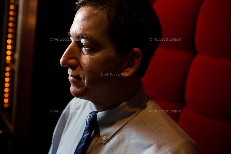 Glenn Greenwald poses for a portrait at the Hotel Marlowe in Cambridge, Massachusetts, USA. Greenwald is a lawyer, blogger, writer, and journalist, known most recently for his role in the Snowden NSA leaks. Greenwald recently received a Polk Award for National Security Reporting, and the 2014 Pulitzer Prize for Public Service.