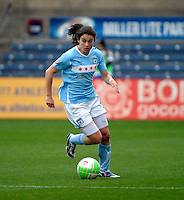 Chicago forward Karen Carney (14) dribbles the ball.  Sky Blue FC defeated the Chicago Red Stars 1-0 at Toyota Park in Bridgeview, IL on April 25, 2010.