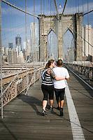 Tenth anniversary of 9/11.  Rebuilding at the World Trade Center site.  Brooklynites stroll over Brooklyn Bridge into Manhattan.  Photo by Ari Mintz.  8/8/2011.