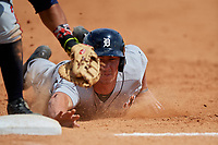 Detroit Tigers Austin Athmann (81) dives back into first base during a minor league Spring Training game against the Atlanta Braves on March 25, 2017 at the ESPN Wide World of Sports Complex in Orlando, Florida.  (Mike Janes/Four Seam Images)
