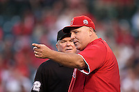 Los Angeles Angels manager Mike Scioscia #14 argues a call with umpire Dana DeMuth during a game against the Baltimore Orioles at Angel Stadium on August 20, 2011 in Anaheim,California. Los Angeles defeated Baltimore 9-8.(Larry Goren/Four Seam Images)