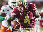Florida State running back Dalvin Cook runs for the game winning touchdown in the fourth quarter of an NCAA college football game against Miami in Tallahassee, Fla., Saturday, Oct. 10, 2015.   The Florida State Seminoles defeated the Miami Hurricanes 29-24.