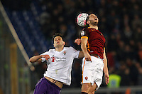 Calcio, Serie A: Roma vs Fiorentina. Roma, stadio Olimpico, 4 marzo 2016.<br /> Fiorentina's Nikola Kalinic, left, and Roma's Kostas Manolas jump for the ball during the Italian Serie A football match between Roma and Fiorentina at Rome's Olympic stadium, 4 March 2016.<br /> UPDATE IMAGES PRESS/Riccardo De Luca