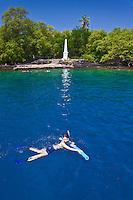 Snorkelers and Captain Cook Monument, Kealakekua Bay Marine Preserve, Captain Cook, Big Island.