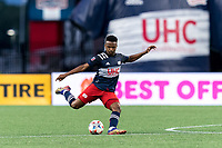 FOXBOROUGH, MA - AUGUST 18: Wilfrid Kaptoum #5 of New England Revolution passes the ball during a game between D.C. United and New England Revolution at Gillette Stadium on August 18, 2021 in Foxborough, Massachusetts.