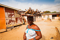 Africa,Ghana,Accra, smoked fish carried on the woman head to the market