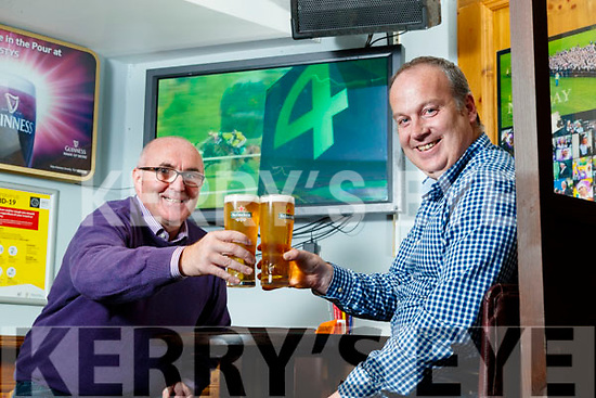 Neilus Slattery, and Jerry O'Neill from Causeway enjoying Listowel races in Christy's the well bar in Listowel on Wednesday.