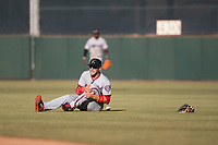 Salt River Rafters second baseman Carter Kieboom (24), of the Washington Nationals organization, clutches onto his left knee after being hit by a ball on a bad hop during the Arizona Fall League Championship Game against the Peoria Javelinas at Scottsdale Stadium on November 17, 2018 in Scottsdale, Arizona. Peoria defeated Salt River 3-2 in 10 innings. (Zachary Lucy/Four Seam Images)