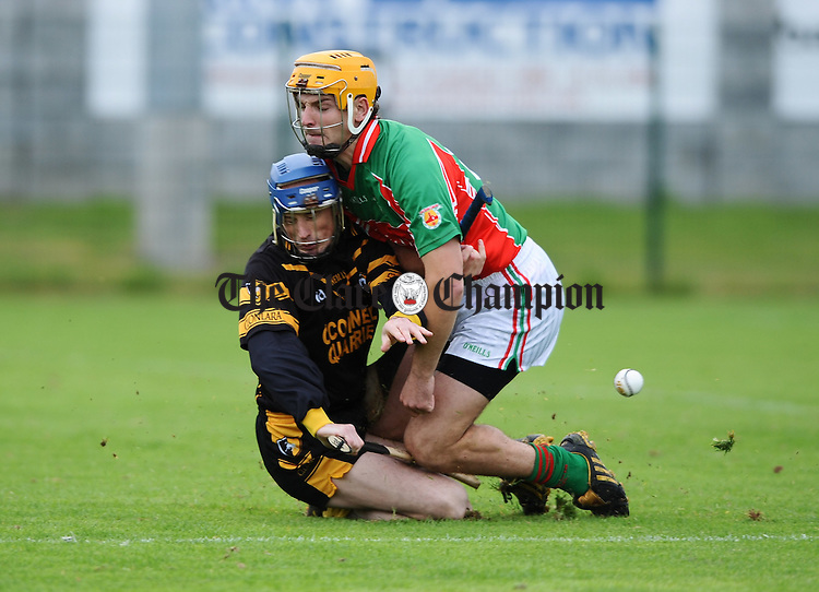 Ger O Connell of Clonlara in action against Martin Duggan of Clooney-Quin during their match at Shannon. Photograph by John Kelly.