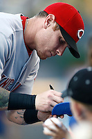 Josh Hamilton of the Cincinnati Reds interacts with fans before a game against the Los Angeles Dodgers in a 2007 MLB season game at Dodger Stadium in Los Angeles, California. (Larry Goren/Four Seam Images)