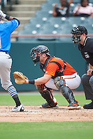 Bowie Baysox catcher Austin Wynns (18) and umpire Brian Peterson wait for the pitch during the first game of a doubleheader against the Akron RubberDucks on June 5, 2016 at Prince George's Stadium in Bowie, Maryland.  Bowie defeated Akron 6-0.  (Mike Janes/Four Seam Images)