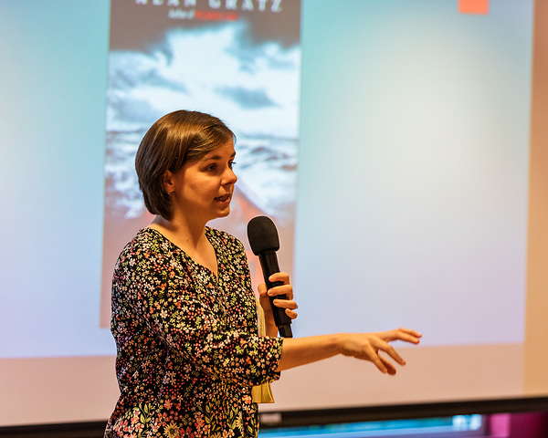 """July 26, 2017. Raleigh, North Carolina.<br /> <br /> Kate Woomer-Deters of the North Carolina Justice Center spoke about refugee issues before Alan Gratz's author talk for his new book """"Refugee"""". Wormer-Deters is the Managing Attorney of Civil Litigation for the Center's immigrant and Refugee Project. <br /> <br /> Author Alan Gratz spoke about and signed his new book """"Refugee"""" at Quail Ridge Books. The young adult fiction novel contrasts the stories of three refugees from different time periods, a Jewish boy in 1930's Germany , a Cuban girl in 1994 and a Syrian boy in 2015."""