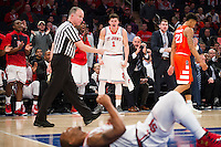 NEW YORK, NY - Sunday December 13, 2015: Amar Alibegovic (#1) of St. John's cheers on his teammate after drawing a foul.  St. John's defeats Syracuse 84-72 during the NCAA men's basketball regular season at Madison Square Garden in New York City.