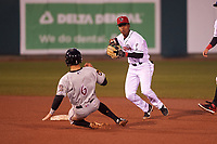 Lansing Lugnuts shortstop Otto Lopez (2) avoids Chad McClanahan (9) on a double play attempt during a Midwest League game against the Wisconsin Timber Rattlers at Cooley Law School Stadium on May 2, 2019 in Lansing, Michigan. Lansing defeated Wisconsin 10-4. (Zachary Lucy/Four Seam Images)