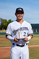 Peoria Javelinas second baseman Keston Hiura (23), of the Milwaukee Brewers organization, poses with the 2018 Arizona Fall League MVP Award before the Arizona Fall League Championship Game against the Peoria Javelinas at Scottsdale Stadium on November 17, 2018 in Scottsdale, Arizona. (Zachary Lucy/Four Seam Images)