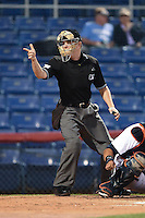Umpire Junior Valentine makes a call during a game between the Bowie Baysox and Binghamton Mets on August 3, 2014 at NYSEG Stadium in Binghamton, New York.  Bowie defeated Binghamton 8-2.  (Mike Janes/Four Seam Images)