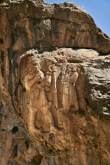 """Picture of the Ivriz Hittite rock relief sculpture monument  dedicated to King Warpalawas in which he talks to Tarhundas the God of Thunder. The king is positioned in the opposite of god, smaller and in a praying position. Warpalawas is saying """"1 am Warpalawas the king of Tuwana, the ruler and a hero. I planted these grapes while I was a young prince in the palace. Let the god Tarhundas give plenitude and fertility."""" Ivriz, Turkey"""