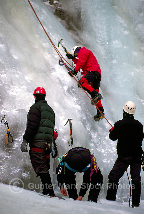 Male Ice Climbers learning to climb on Frozen Waterfall at Ice Climbing Clinic, Marble Canyon Provincial Park, Southwestern British Columbia, Canada