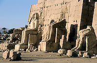 Partially ruined statues in front of the Eight Pylon at Karnak Temple, Luxor, Egypt.