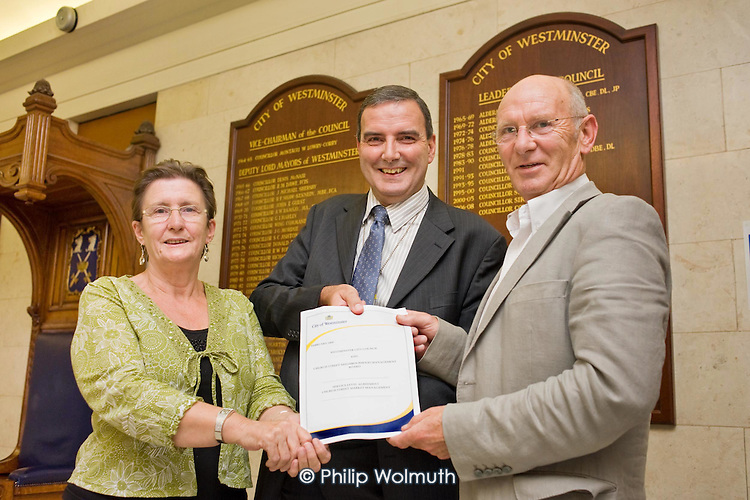Jeannette Buckley, Chair of Church Street Neighbourhood Forum, Jeff Harris, Westminster Council Assistant Director of Community Protection, and Neil Johnston, CEO of Paddington Development Trust, with a new Service Level Agreement for Church Street Market at Marylebone Council House.