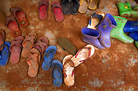 Children's shoes lie outside a classroom door in a village in Northern Thailand.