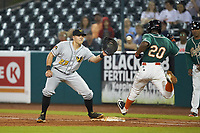 West Virginia Power first baseman Mason Martin (23) waits for the throw as Samuel Castro (20) of the Greensboro Grasshoppers lunges for the bag at First National Bank Field on June 1, 2018 in Greensboro, North Carolina. The Grasshoppers defeated the Power 10-3. (Brian Westerholt/Four Seam Images)