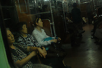 Commuters in the Pyongyang in a Metro train, PyongYang, North Korea.